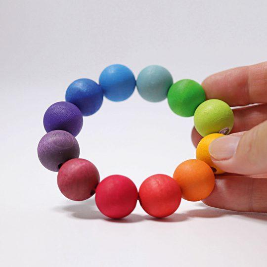 Agarre/mordedor pulsera bolas Arco Iris